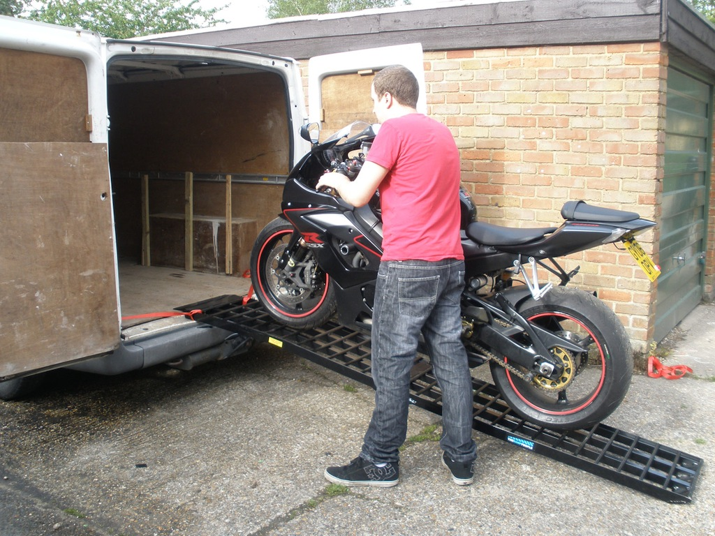 A motorbike being loaded in to the back of a van using The Ramp People's Black Widow Motorcycle Ramp