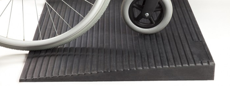 Wheelchair on a rubber threshold ramp