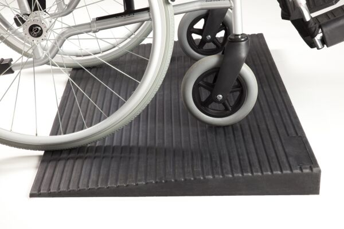 Wheelchair on rubber threshold ramp